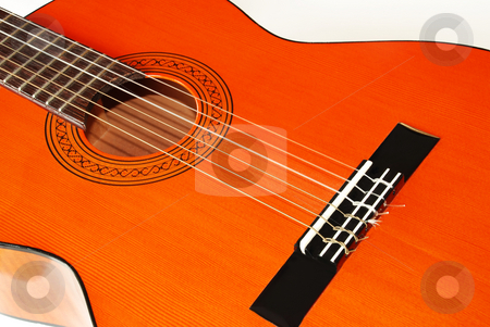Acoustical guitar stock photo, Wooden orange acoustical guitar fragment over white by Julija Sapic