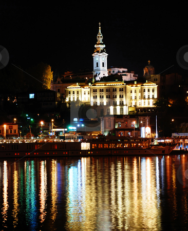 Night cityscape stock photo, Night illuminated Belgrade from river with light reflection by Julija Sapic