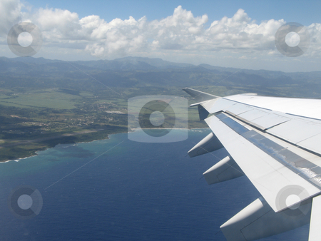 Airplane wings during flight stock photo,  by Mbudley Mbudley