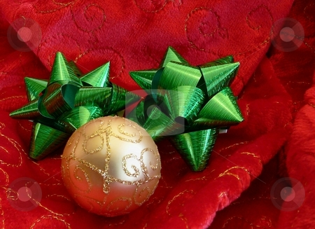 Christmas stock photo, Christmas design with red and gold on velvety fabric by Perry Correll