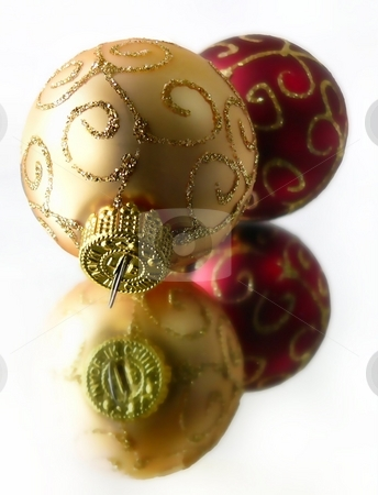 Christmas Ornaments stock photo, Gold and Red Christmas ornaments sitting on mirror by Perry Correll