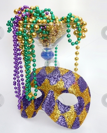 Mardis Gras stock photo, Mardi Gras beads and harlequin mask by Perry Correll