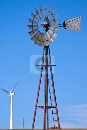 Windmill for cattle water against wind turbines stock photo, Water windmill surrounded by wind turbine generators by RCarner Photography