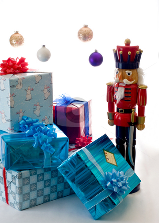 Christmas, the magic time of year stock photo, A large nutcracker stands guard over the presents by RCarner Photography