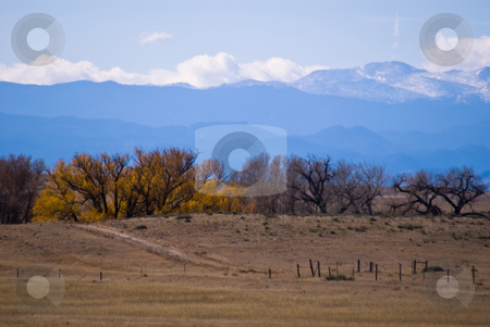 Clouds forming over the Colorado Rockies stock photo, An autumn scene looking west towards the Rock Mountains. by RCarner Photography