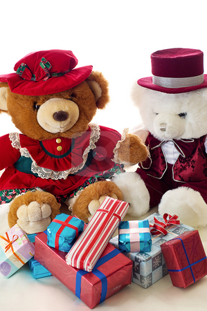 Teddy bear Christmas stock photo, Two teddy bears exchange gifts for Christmas by RCarner Photography