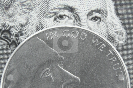 In God We Trust stock photo, George Washington behind Jefferson nickel. by Todd Dixon