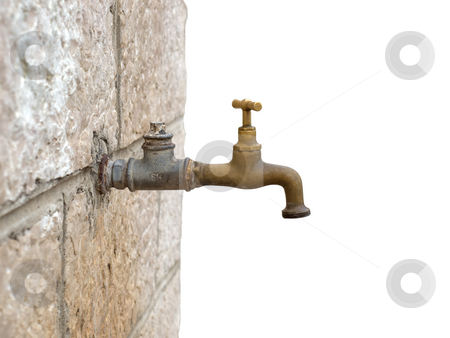 Old Faucet stock photo, Just an old faucet on a stone wall with a clear background. by Sinisa Botas