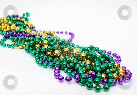 Mardis Gras stock photo, Mardis gras image of beads and harlequin mask by Perry Correll