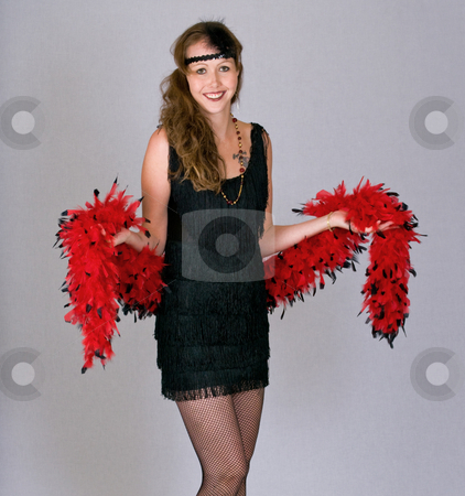Young woman dressed as a 1920's flapper stock photo, Flapper model with boa and fishnet stockings by RCarner Photography