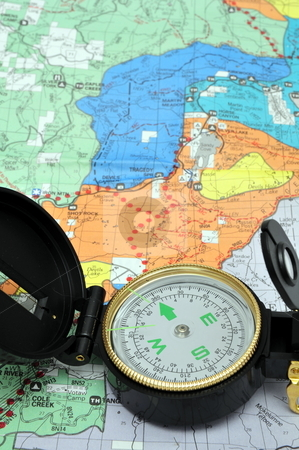 Lensatic Compass And Map stock photo, A black lensatic compass on hiking map by Lynn Bendickson