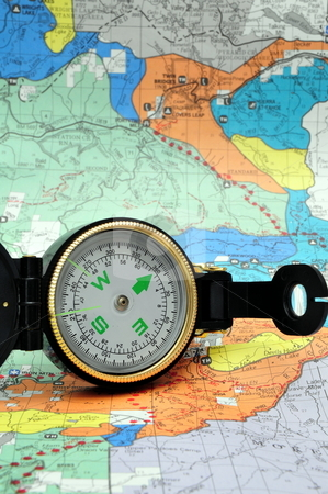 Black Lensatic Compass  stock photo, A black lensatic compass on hiking map by Lynn Bendickson