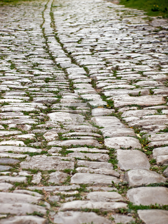 Ancient road stock photo, Close up of ancient road with smooth stone tiles. by Sinisa Botas