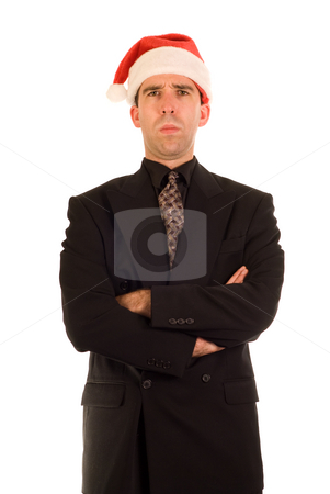 Grumpy Christmas Employee stock photo, A employee wearing a santa hat, looking grouchy by Richard Nelson