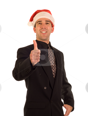 Christmas Businessman stock photo, A young businessman wearing a christmas cap and giving the thumbs up by Richard Nelson