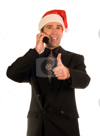 Xmas Thumbs Up stock photo, Businessman giving the thumbs up sign while talking on a cell phone by Richard Nelson