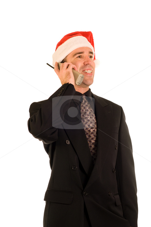 Xmas Phone Call stock photo, Businessman making phone calls on Christmas by Richard Nelson