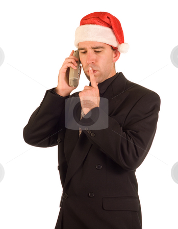 Christmas Thinking stock photo, A young businessman talking on the phone while thinking by Richard Nelson