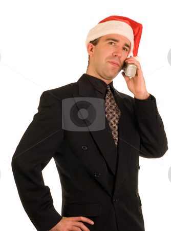Christmas Conversation stock photo, A young employee having a conversation on the phone during Christmas by Richard Nelson