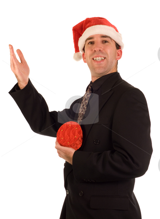 Christmas Gift Exchange stock photo, An employee wearing a suit holding a Christmas gift by Richard Nelson