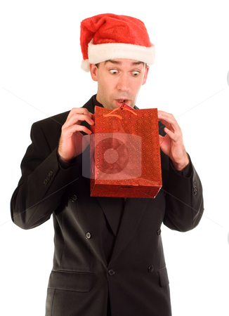 Early Peek stock photo, A businessman looking at his gift before Christmas by Richard Nelson