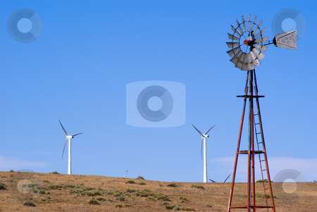 Water well and wind turbines stock photo, Wind pumping water and electricity by RCarner Photography