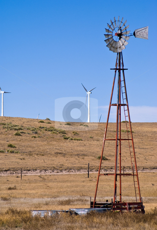 Old use for wind and new stock photo, Windmill pumping water for livestock by RCarner Photography