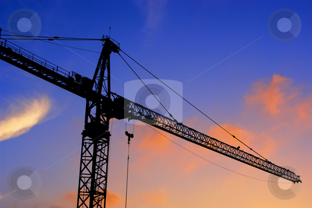 Construction crane at sunset stock photo, Construction crane at sunset by Craig Steven Thrasher