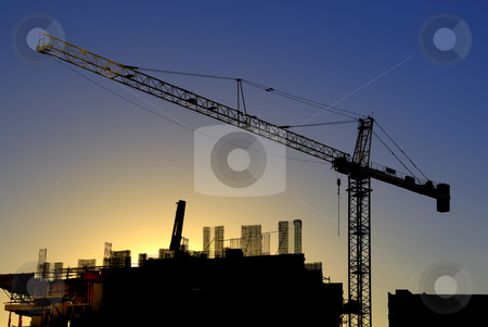 Construction site at sunset stock photo, Construction site at sunset by Craig Steven Thrasher