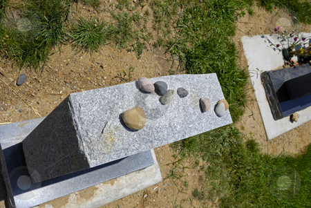 Stones on Grave Marker in Jewish Cemetery stock photo, Stones on Grave Marker in Jewish Cemetery by Craig Steven Thrasher