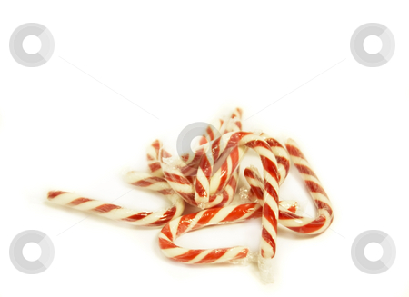 Candy Canes stock photo, Miniature candy canes on white background. Focus on top candy cane. by Julie Bentz