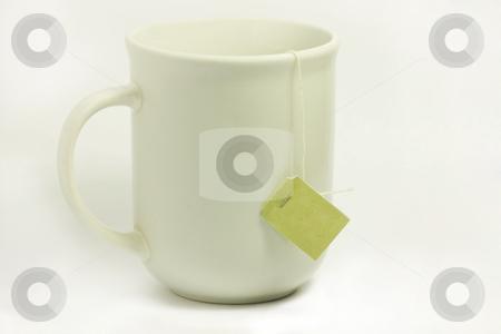 Tea Mug with Tag stock photo, White mug with tea tag hanging down the side. by Julie Bentz