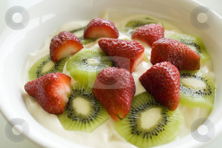 Fruit yoghurt breakfast stock photo, Large bowl of yoghurt with sliced fresh fruit on top by Stephen Gibson