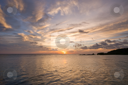 Golden reflection stock photo, Pastel sunset with golden reflection on the ocean by Karin Claus