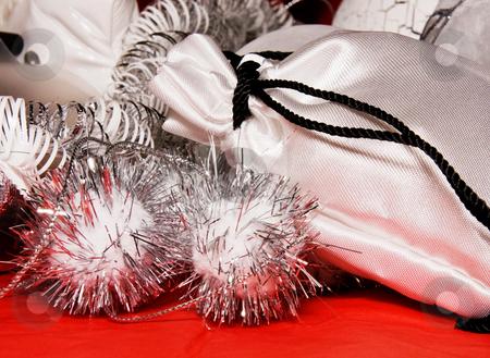 Xmas decoration with gift bag  stock photo, Xmas decoration with gift bag on a red cloth by Karin Claus
