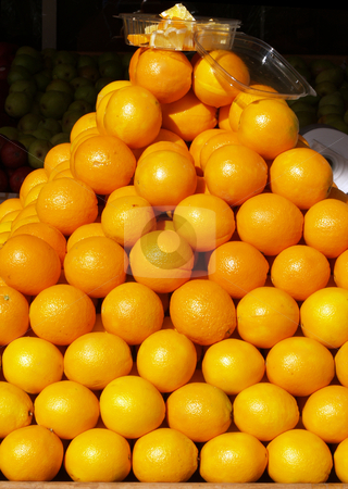 Pyramid of oranges in store front display stock photo, Oranges stacked in display outside of store by Jeff Cleveland