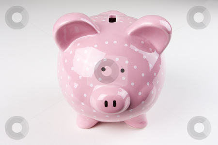 Pink Spotty Piggy Bank stock photo, A pink spotted piggy bank in center frame by Steve Smith
