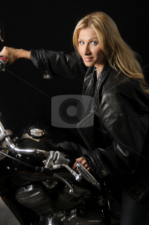 Woman on a Motorcycle stock photo, Woman enjoying her motorcycle by Timothy OLeary