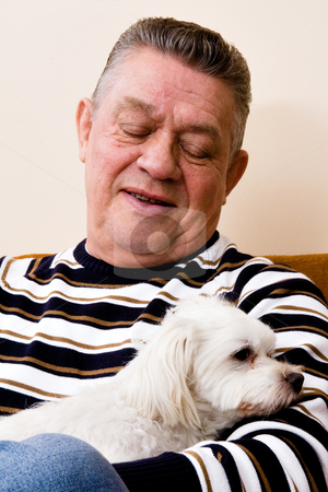 Grandfather giving his dog a loving look stock photo, Older man with his dog he clearly loves very much by Frenk and Danielle Kaufmann