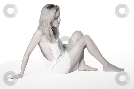 Beatiful young woman sitting on the floor stock photo, Portrait of a beautiful young woman dressed in only a white shirt by Frenk and Danielle Kaufmann
