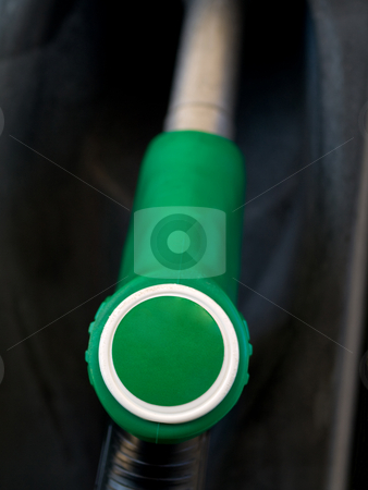 Green  gas pump  stock photo, Green gas pump closeup with black background by Laurent Dambies