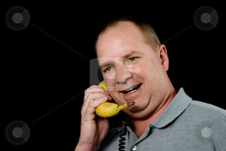 Banana Phone stock photo, A man talking on a banana phone. by Robert Byron
