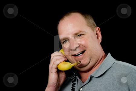 Banana Phone stock photo, A man talking on a banana phone. by Robert Byron