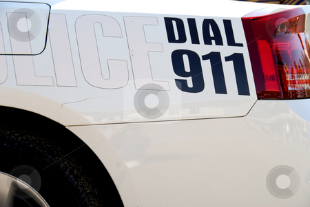 Dial 911 stock photo, A message on the back of a police car: Dial 911. by Robert Byron