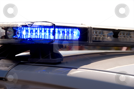 Blue Lights stock photo, The light bar on top of a police cruiser. by Robert Byron