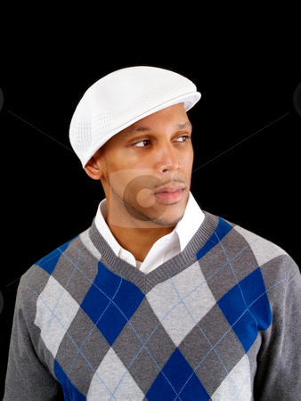 Young black man in sweater and white cap stock photo, Young black man in white cap and sweater by Jeff Cleveland