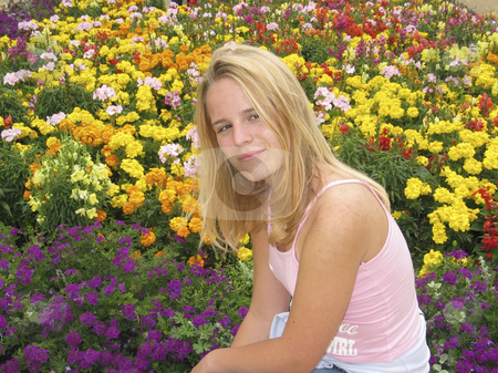 Young teenage girl between flowers stock photo, Young teenage girl between flowers by Lothar Hinz