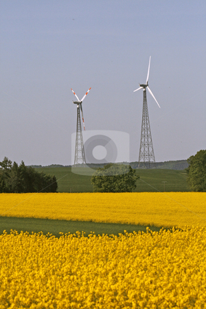 Wind power station with rape field in Allendorf, Lower Saxony, Germany stock photo, Wind power station with rape field in Allendorf, Lower Saxony, Germany by Lothar Hinz