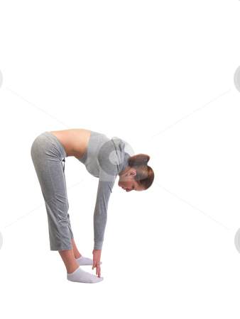 Young Woman Stretching touching toes in sweats stock photo, Young Woman Touching Her Toes  in sweat clothes by Jeff Cleveland