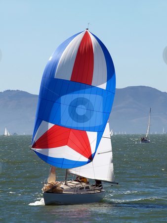Sailboat running with the wind under spinnaker stock photo, Sailboat underway running with wind by Jeff Cleveland